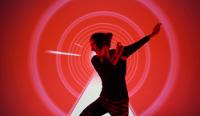 Une danseuse devant une projection de tunnel rouge en infographie